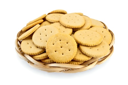 Crackers in a wicker plate isolated on white background photo