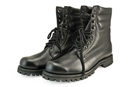 A pair of tall black leather boots army is isolated on a white background photo