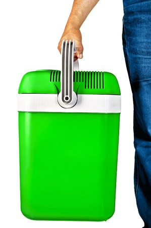 Green a small portable cooler for travel in the hands of a man isolated on white background