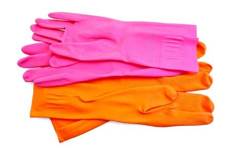 Orange and pink rubber gloves isolated on white background photo