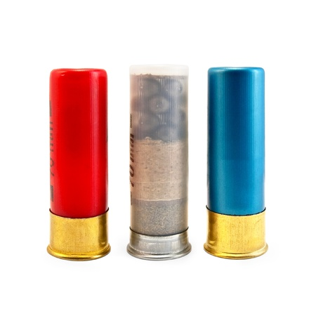 Three ammunitions for the shotgun, red, blue and white isolated on white background photo