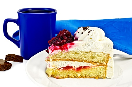 A piece of cake with white cream and red jelly on the plate, blue coffee mug with two pieces of chocolate, blue napkin isolated on white background photo