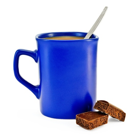 porous: Coffee with milk, a silver spoon in a blue mug, two slices of porous brown chocolate isolated on white background Stock Photo