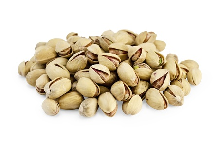 Heap of savory pistachio isolated on white background photo