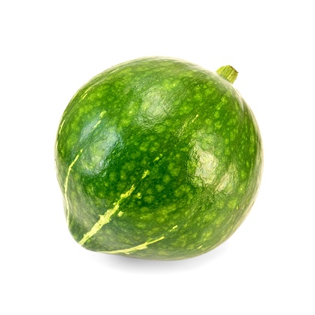 Green pumpkin with yellow stripes isolated on white background photo