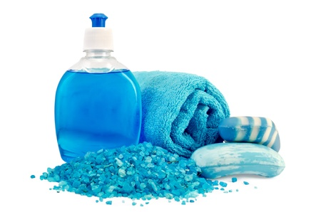 solid blue background: Blue liquid soap in a bottle, solid blue striped and mottled soap, bath salt, blue towel isolated on white background Stock Photo