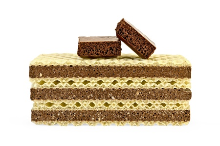 A stack of wafers with a layer of porous chocolate, two slices of porous chocolate isolated on white background photo