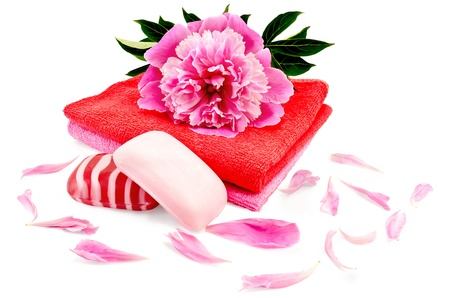 Solid red and pink striped soap, two towels and a pion is isolated on a white background Reklamní fotografie