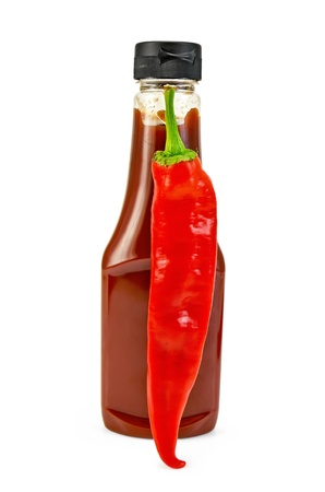 Tomato ketchup in a plastic bottle, pod hot pepper isolated on white background photo