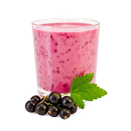 Glass with milkshake, berries and a green leaf of a black currant it is isolated on a white background photo