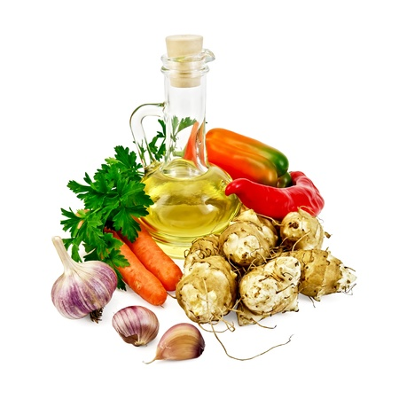 Tubers of Jerusalem artichoke, garlic, carrots, parsley, sweet and spicy red pepper, a bottle of vegetable oil isolated on white background photo