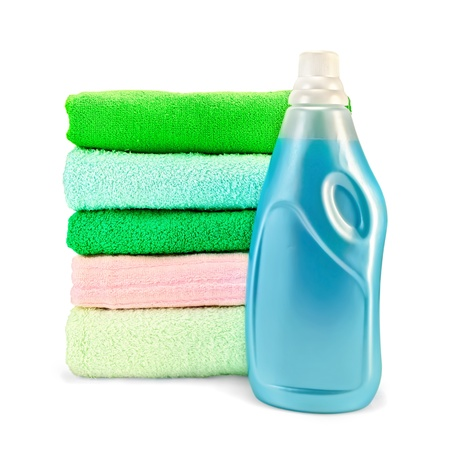 One bottle of blue fabric softener, stack of towels isolated on white background