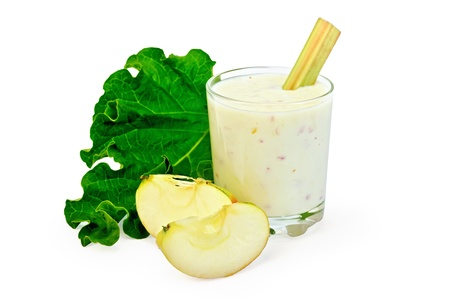 Dairy cocktail in a glass with leaves and rhubarb stalks, slices of apple isolated on a white background photo