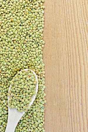 Lentils green on board on the left with spoon photo