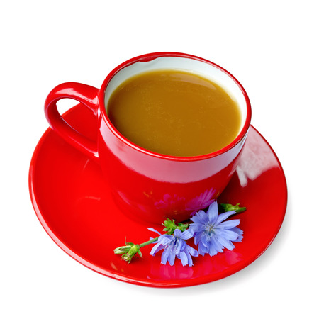 surrogate: Chicory drink in red cup on saucer Stock Photo