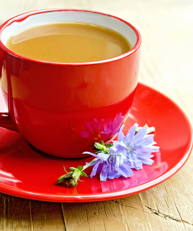 chicory coffee: Chicory drink in red cup with flower on saucer