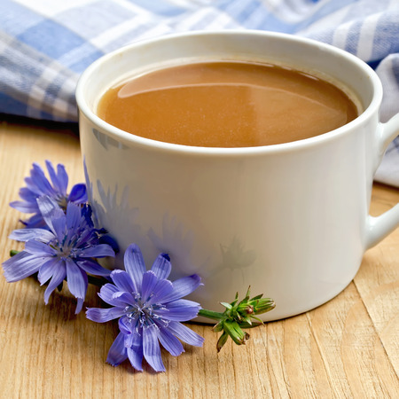 chicory coffee: Chicory drink in white cup on board