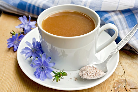 chicory coffee: Chicory drink in white cup with flower and spoon on board