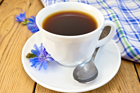 chicory coffee: Chicory drink in white cup with flower and napkin on board