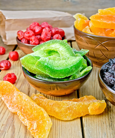 Candied pomelo and fruit in bowl on board photo