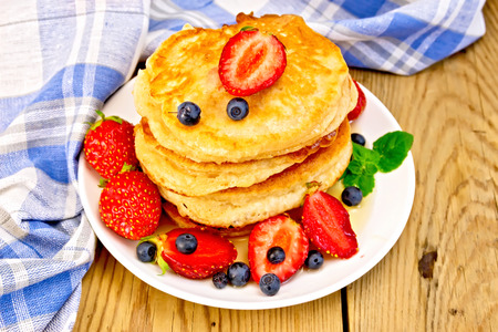 flapjacks: Flapjacks with strawberries and blueberries on board