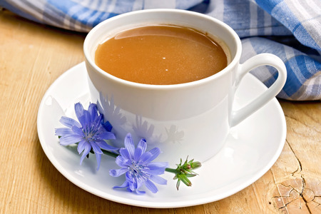 chicory coffee: Chicory drink in white cup with flower on board