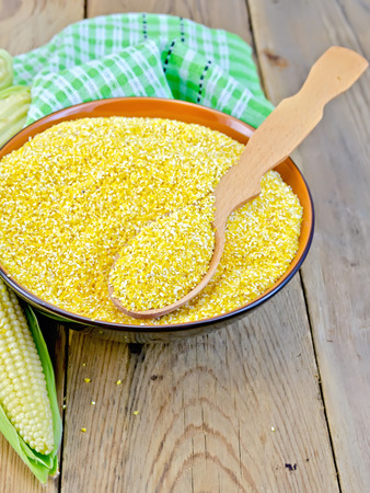 grits: Corn grits with cob and spoon on board