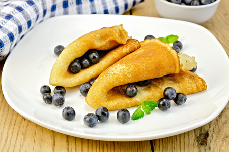 rubicund: Pancakes with blueberries and napkin on board