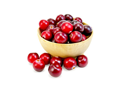 Cranberries ripe in wooden bowl photo