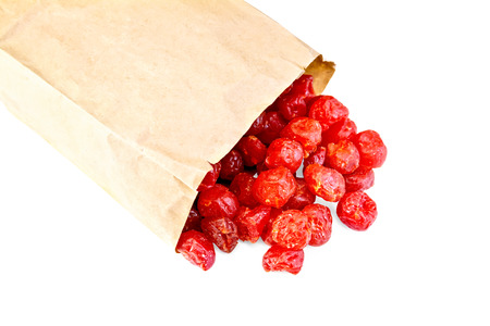 Candied cherry in paper bag photo