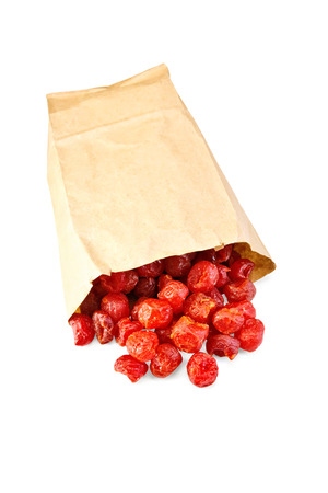Candied dried cherry in paper bag photo