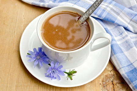 chicory coffee: Chicory drink in white cup with spoon on board Stock Photo