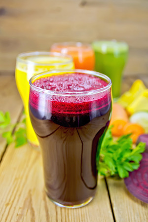 Juice beetroot and vegetable with parsley on board photo