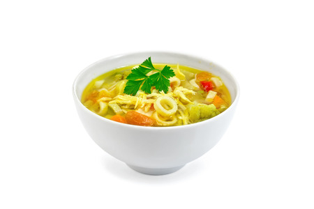 soup bowl: Minestrone soup with meat, celery, tomatoes, zucchini and cabbage, green peas, carrots and pasta in a bowl isolated on white background Stock Photo