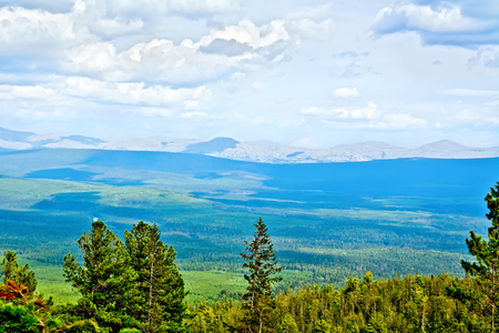 View of the ridge Kvarkush covered by forest in the Ural Mountains