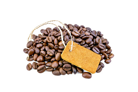 grained: Grains of black coffee with a tag and green leaves on a isolated white background Stock Photo