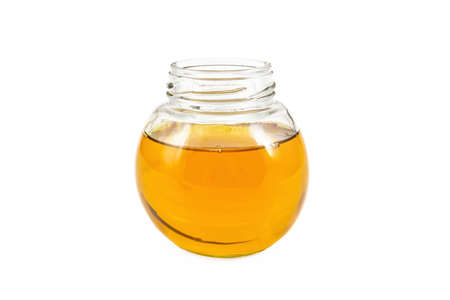 Vegetable oil in glass jar isolated on white background