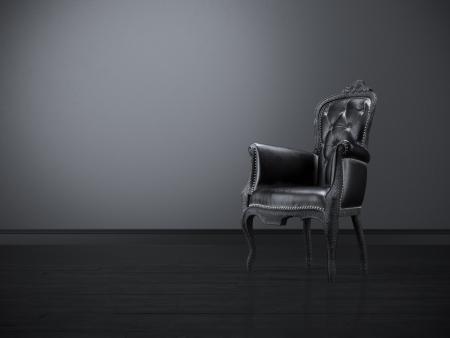 Vintage black chair in the dark room  Stock Photo