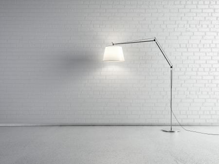 Lámpara delante de una pared de ladrillo