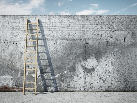 escape: Ladder on wall in front of sky Stock Photo
