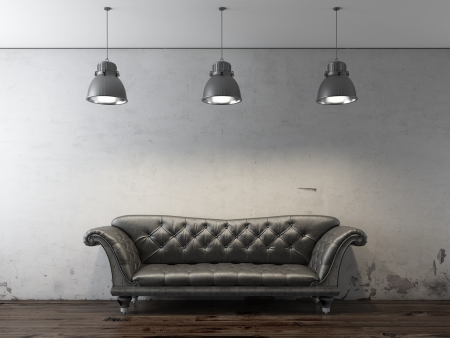 couches: Black sofa in front of grunge wall