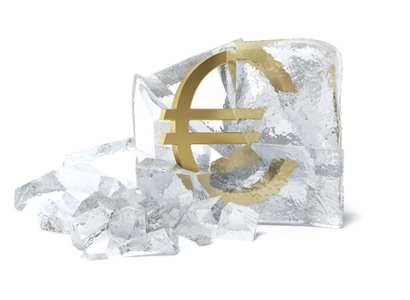 Golden Euro symbol frozen inside an ice cube Stock Photo - 16557524