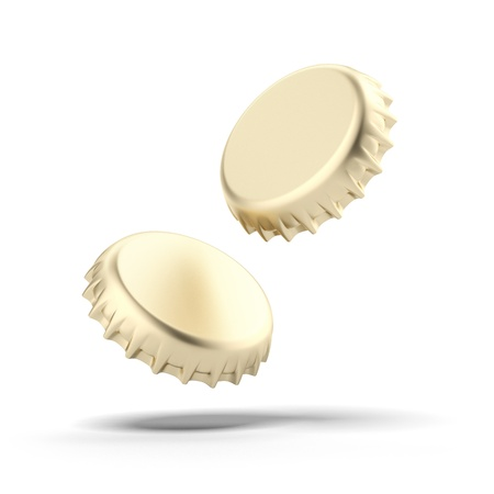 non alcoholic beer: Two golden bottle caps isolated on a white background