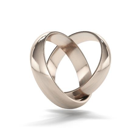 白い背景に分離されたハート型のゴールドの結婚指輪のカップル