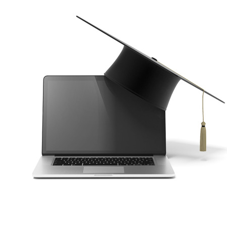 Grad hat and laptop  isolated on a white background Stock Photo - 22401742
