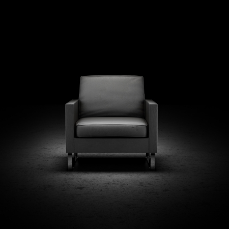 black chair isolated on a black background photo