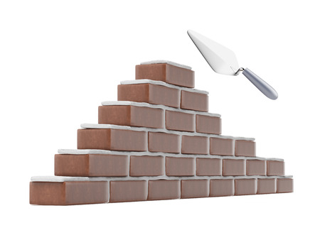 bricklayer: Trowel and brick wall isolated on a white background Stock Photo