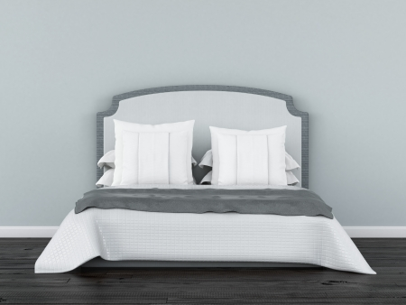 white bed in front of a blue wall Stock Photo - 22402744