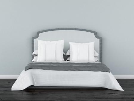 wit bed in de voorkant van een blauwe muur