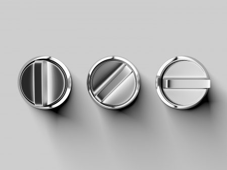 Three metal buttons isolated on a white background photo